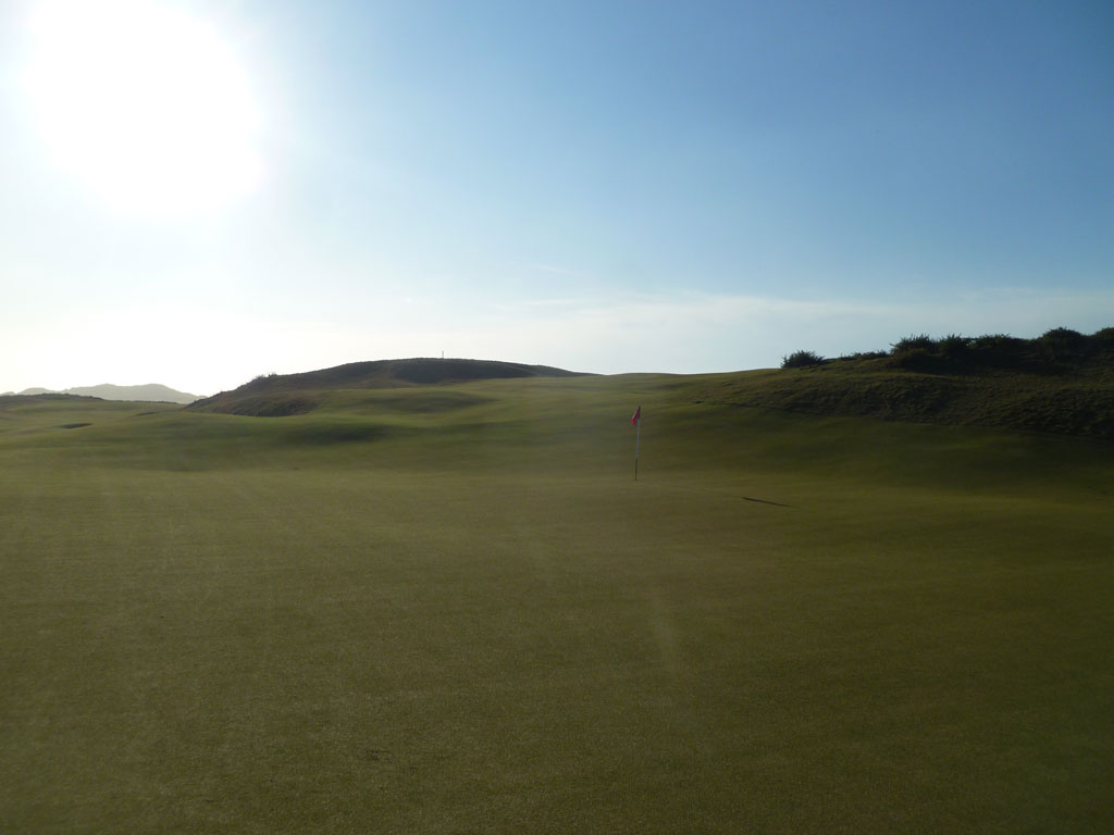 Standing behind the green and looking back towards the green on the 16th Hole at Old Macdonald