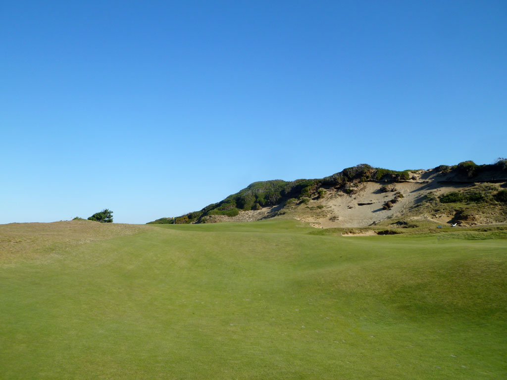 A blowout bunker on the leeward side of a dune - 13th Hole at Pacific Dunes